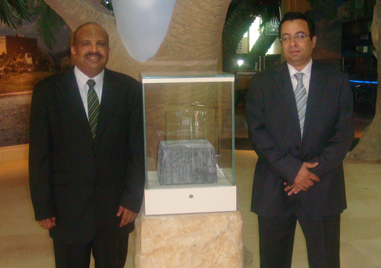 Abdel Monim (right) and Dr Osama Abdel Warth with the International Award trophy